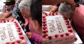 Empujan a abuelita a pastel y causa indignación en redes sociales.